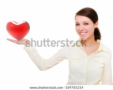 Girl with heart in hand, valentines day - stock photo