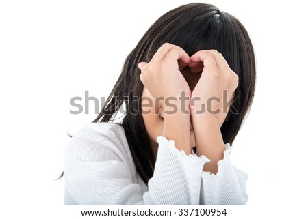 Girl with heart shape sign with hands over her face. Love concept.
