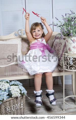 Girl with hearts in provence style interior  - stock photo