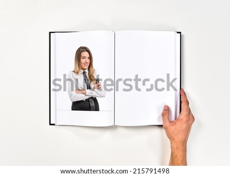 Girl with her arms crossed printed on book - stock photo