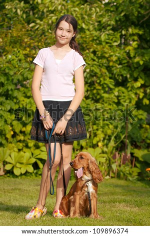 Girl with her dog in nature - stock photo