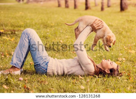 Girl with her dog resting outdoors - stock photo