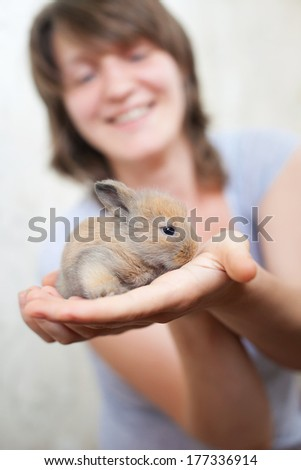 Girl with her lovely pet - baby  rabbit