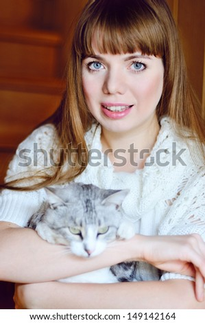 girl with her pet cat - stock photo
