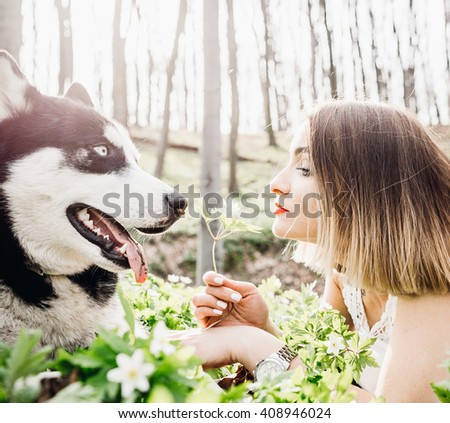 girl with his big dog playing outdoors - stock photo