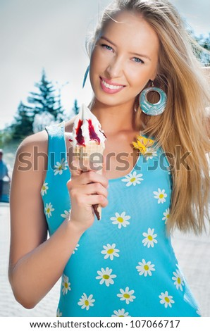 Girl with ice cream on the street