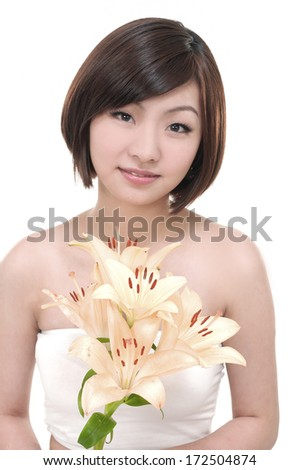 Girl with lily-close up - stock photo