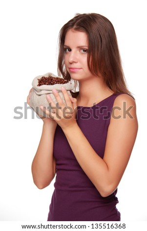 girl with long dark hair  holding a bag of coffee beans on a white background on Food and Drink