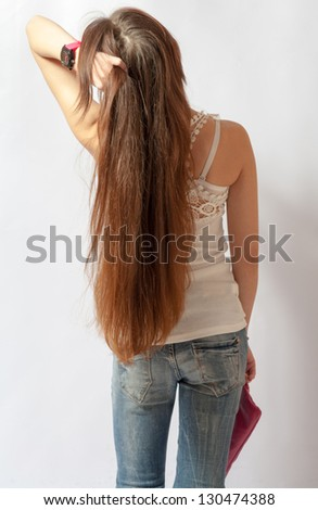 Girl with long fair hair from back, on white background. - stock photo
