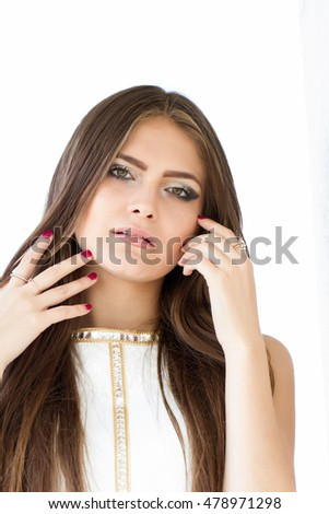 girl with long hair and bright makeup