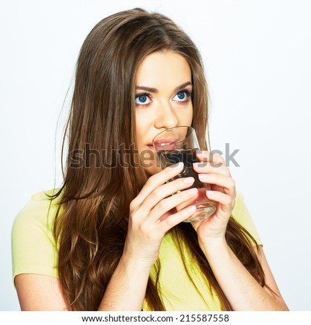 girl with long hair drink water of glass . isolated portrait .