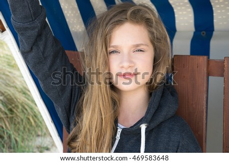 Girl with long hair in a beach chair / girl with long hair / beach chair