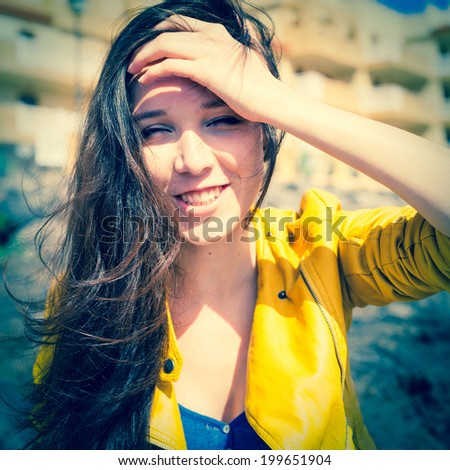 girl with long hair posing outdoor - stock photo