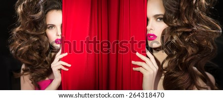Girl with luxuriant hair backstage theater opens - stock photo