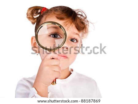 girl with magnifier isolated on a white background