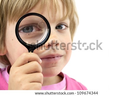 Girl with magnifying glass on white background - stock photo