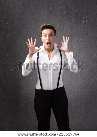 girl with man dress unbelievable faces - stock photo
