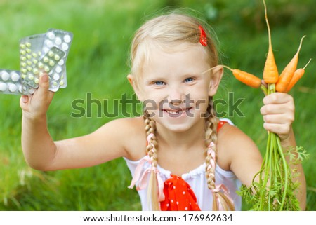 girl with medicine and carrots - stock photo