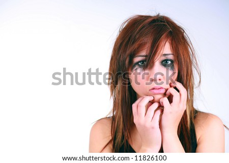 girl with messy hair and makeup crying - stock photo