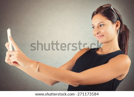 Girl with mobile phone likes to shoot - stock photo
