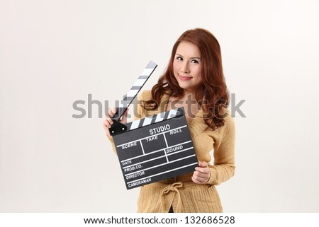 Girl with Movie Slate on the white background - stock photo