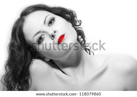 girl with naked shoulders looking in camera on white background