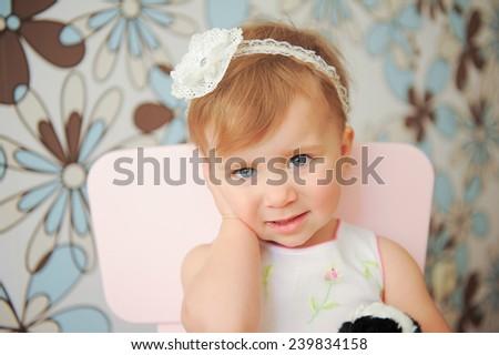 girl with nice headband touching her ear - stock photo