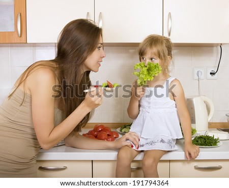 girl with no appetite - kid does not want to eat salad