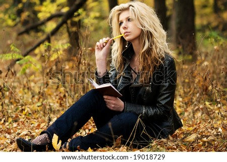 Girl with notepad - stock photo