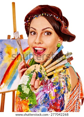 Girl with open mouth holding hands on background of easel. Isolated. - stock photo