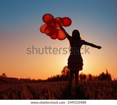 girl with orange balloons outdoor - stock photo