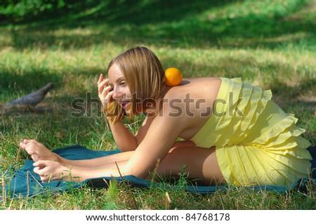 girl with orange yoga outdoors - stock photo