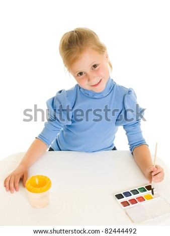 Girl with paint on a white background. - stock photo