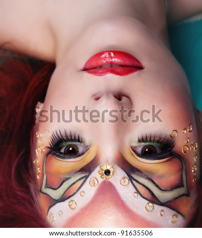 Girl with painted face - stock photo