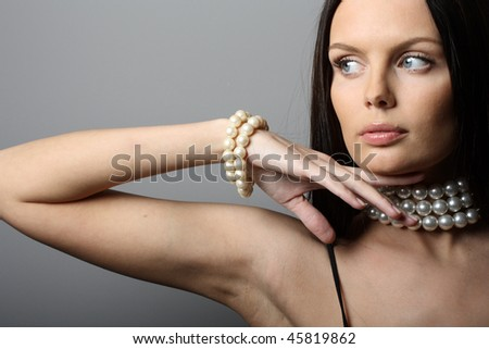 Girl with pearl jewelry - stock photo