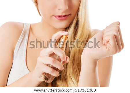 Girl with perfume, young beautiful woman holding bottle of perfume.