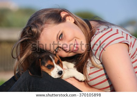 girl with pet puppy dog - stock photo