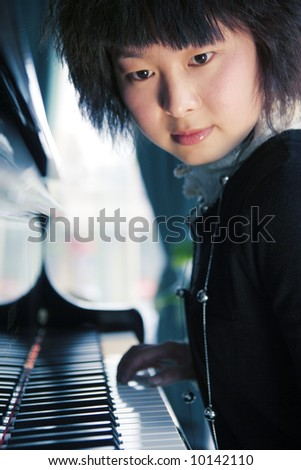 girl with piano - stock photo