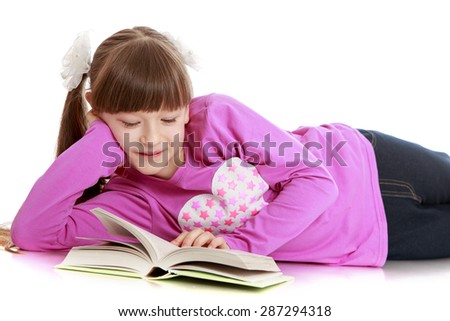 Girl with pigtails lies on the floor and reading a book-Isolated on white background - stock photo