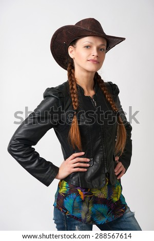 girl with pigtails wearing cowboy hat - stock photo