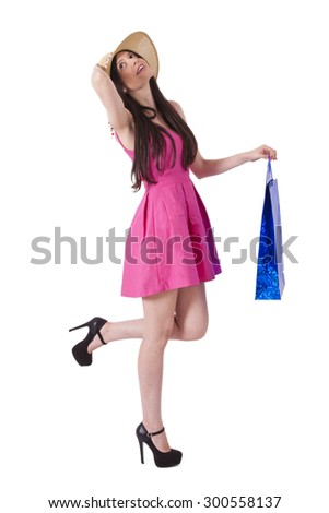girl with pink dress and blue bag