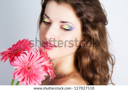 Girl with pink flowers in studio - stock photo