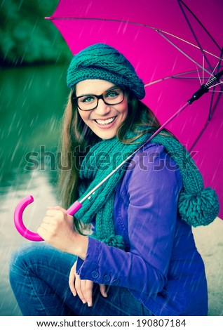 girl with pink umbrella in the rain - stock photo