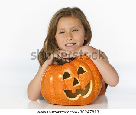 girl with pumpkin on white