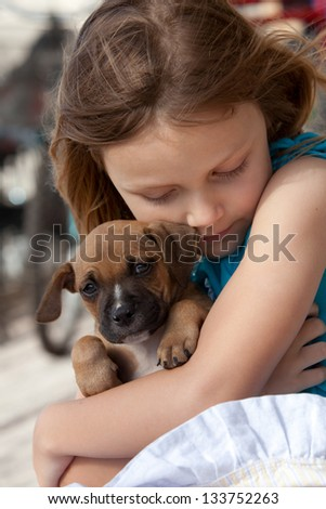 girl with puppy dog