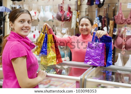Girl with purchases at  counter in underwear shop