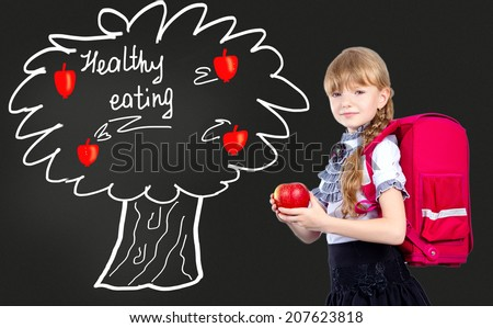 girl with red apple. Healthy eating - stock photo