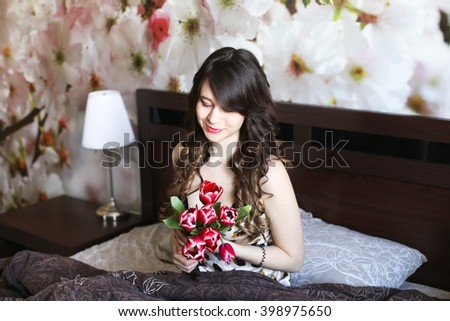 Girl with red flowers in the bed 1