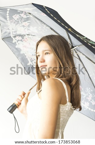 girl with red hair under the umbrella closeup - stock photo