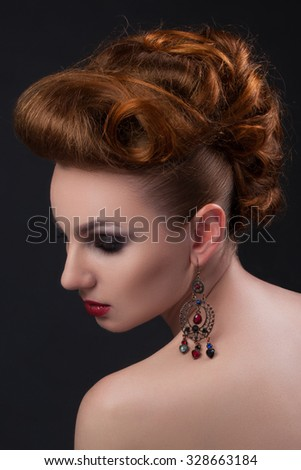 girl with red hair with black shadows for eyes retro vintage